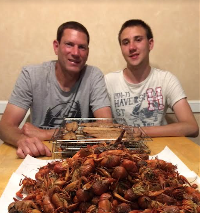 Jake and Mike smoking crawfish to eat